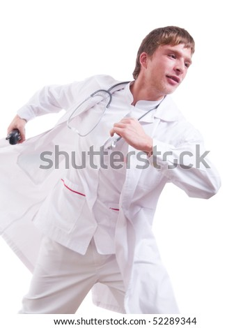 Handsome young doctor with phone running against white background.