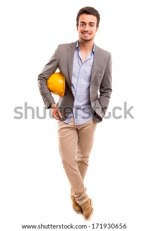 Handsome young engineer posing isolated over white background - stock photo