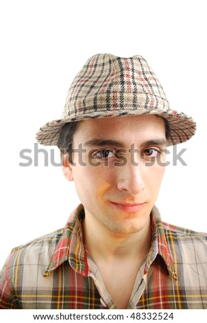 handsome young farmer from the countryside with checked hat (over white background) - stock photo