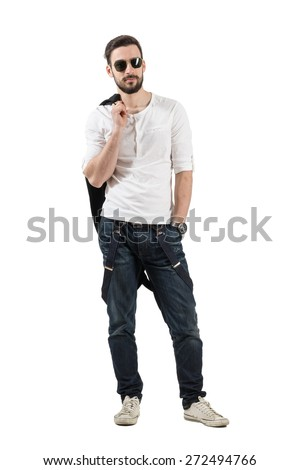 Handsome young fashion male model posing with jacket over his shoulder. Full body length portrait isolated over white background.  - stock photo