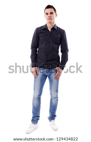 Handsome young guy in full length pose, isolated on white background