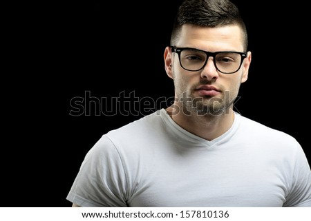 Handsome young guy with glasses posing