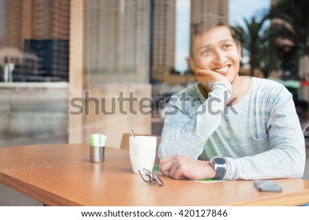 handsome young indian man relaxing in a cafe in Dubai - stock photo