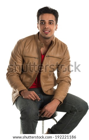 Handsome young Indian man with a cheerful expression - stock photo