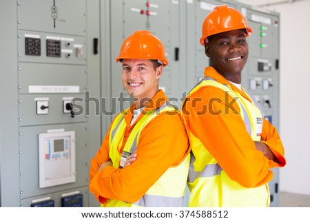 handsome young industrial engineers with arms crossed - stock photo