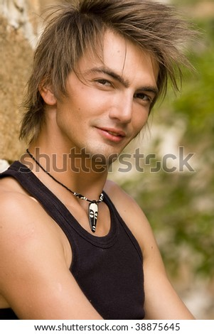 handsome young loose man close-up portrait - stock photo