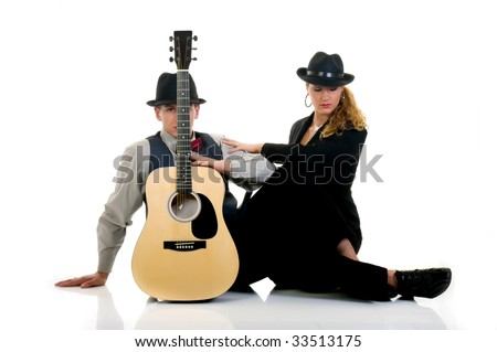 Handsome young male and female musicians, performers with guitar. Studio shot, white background.