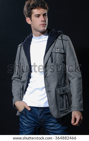 handsome young male in jeans on black background - stock photo