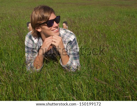 Handsome young male outdoor enjoying nature - stock photo