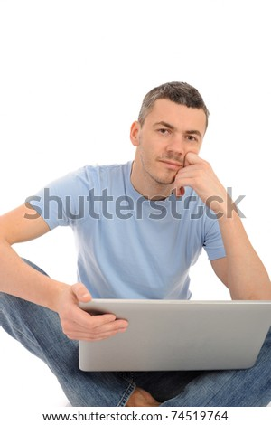 handsome young male working on laptop computer. isolated