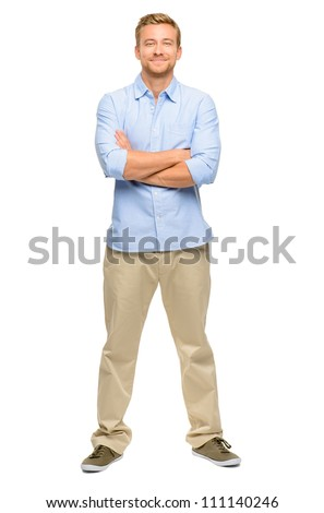 Handsome young man arms folded full length white background - stock photo