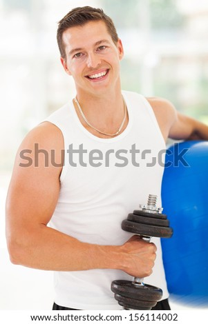 handsome young man at the gym after working out - stock photo