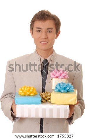 Handsome young man carrying gifts - stock photo