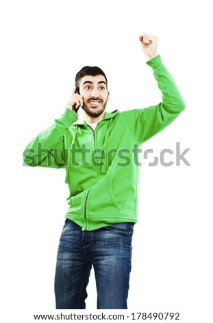 Handsome young man cheering during phone call. Isolated on a white background  - stock photo