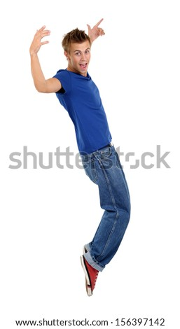 Handsome young man dancing isolated on white