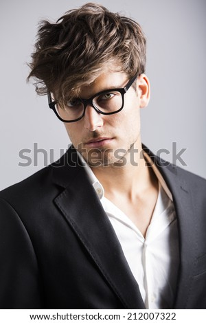 Handsome young man dressed elegantly - stock photo