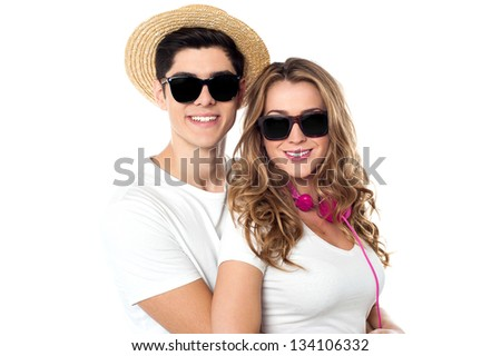 Handsome young man embracing his girlfriend from behind. - stock photo