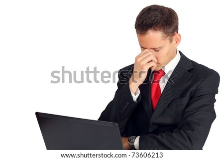 Handsome young man feeling ill by his laptop - stock photo