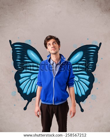 Handsome young man girl with butterfly blue illustration on the back - stock photo