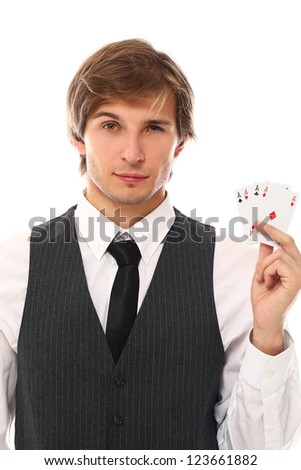 Handsome young man holding playing cards in hand - stock photo