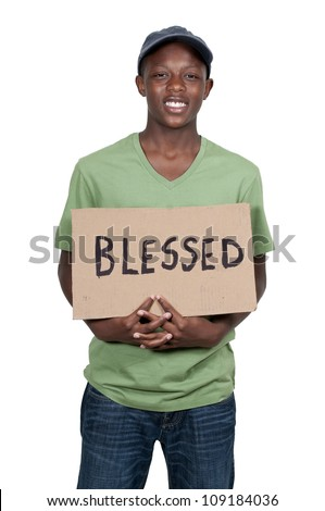 Handsome young man holding up a sign that says Blessed - stock photo