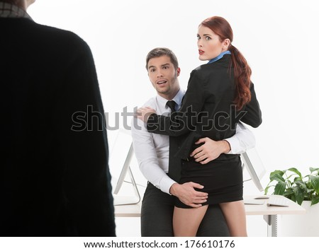 stock photo handsome young man hugging woman beautiful couple kissing caught by surprise 176610176