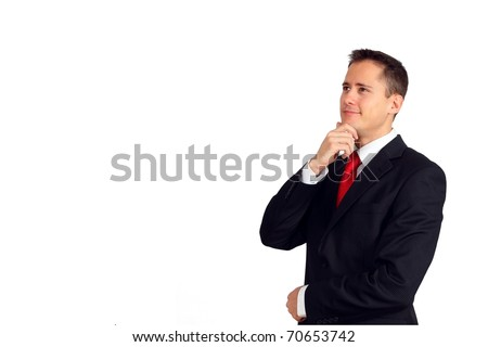 Handsome young man in a suit having an idea or looking up at something