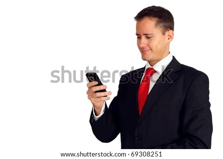 Handsome young man in a suit looking at his smartphone