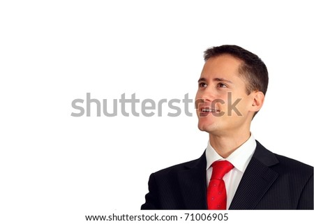 Handsome young man in a suit looking up at something or having an idea - stock photo