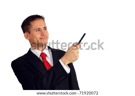Handsome young man in a suit pointing with a pen - stock photo