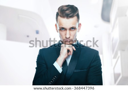 Handsome young man in a tuxedo looking at the camera. Fashionable Clothing. Clothing for the festive evening