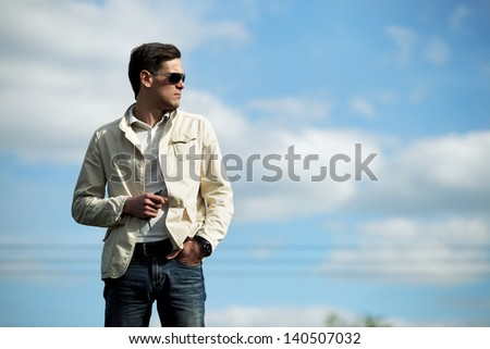 handsome young man in a white jacket street fashion - stock photo