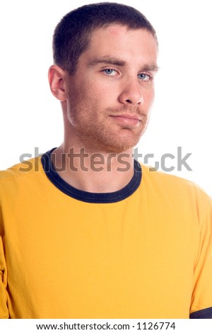 Handsome young  man in a yellow t-shirt,