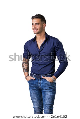 Handsome young man in blue shirt and jeans posing isolated on white background in studio,smiling