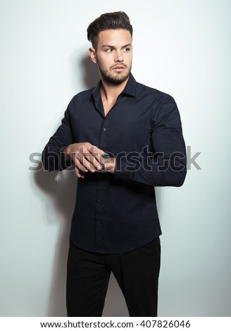 handsome young man in business man wearing a wristwatch - stock photo