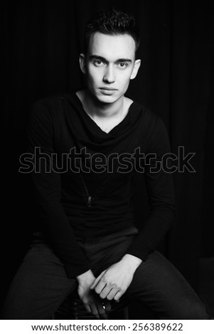 Handsome young man in casual clothes, black and white picture - stock photo