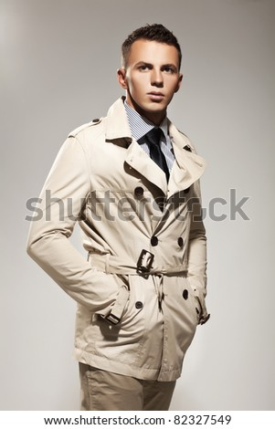 Handsome young man in gray coat