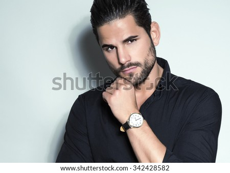 handsome young man in suit on grey background. Business man - stock photo