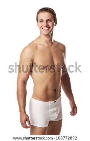 Handsome young man in underwear against white background