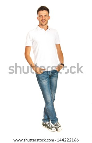 Handsome young man in white blank t-shirt and jeans posing isolated  on white background