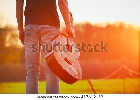 Handsome young man is enjoying in springtime - stock photo