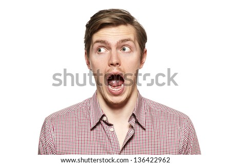 Handsome young man isolated over white. Funny face. - stock photo
