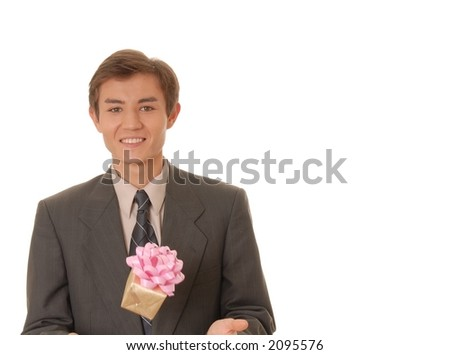 Handsome young man juggling a wrapped gift - stock photo