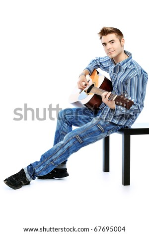 Handsome young man musician playing his guitar. Isolated over white background.