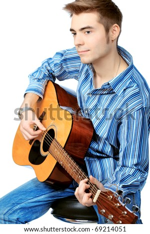 Handsome young man musician playing his guitar. Isolated over white background. - stock photo