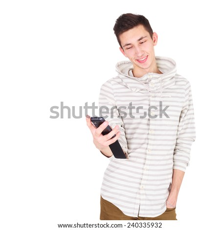 handsome young man of fashion with the phone - stock photo