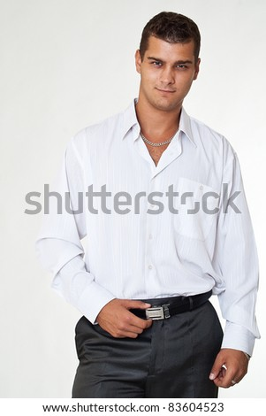 Handsome young man on gray  background - stock photo