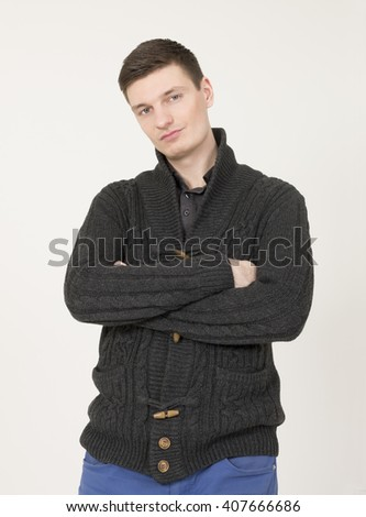 Handsome young  man on the grey background. - stock photo