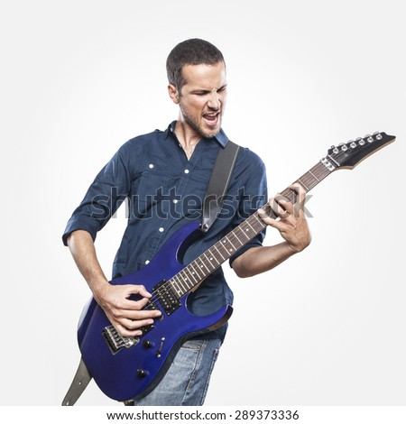 handsome young man playing electric guitar