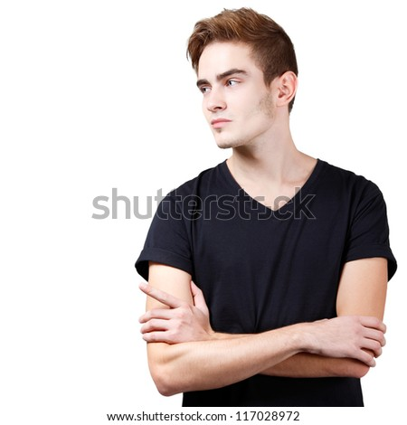 Handsome young man pointing at copyspace with his hand, portrait of sexy guy looking right over white background - stock photo